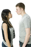 Young  Couple. A young couple talking together in a studio Royalty Free Stock Photos