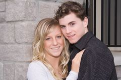 Young couple. Teenage couple smiling, outside Royalty Free Stock Photo