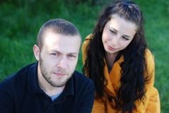 Young Couple. In outside. Girl looking her boyfriend lovely Royalty Free Stock Images