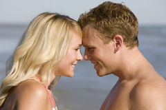 Young Couple. A young couple looking into each others eyes Stock Image