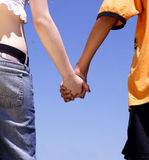 Young couple. Hold with hands Royalty Free Stock Photo