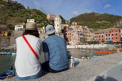 A young couple admires a romantic view of Vernazza Royalty Free Stock Photography