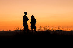 Young couple admiring sunset Royalty Free Stock Image