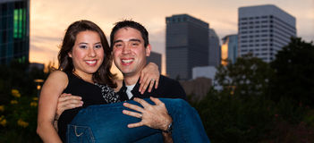 Young couple. In a affectionate pose in a urban downtown park  setting at sunset Stock Photography