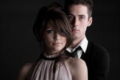 Young Couple against Dark Background Royalty Free Stock Photography