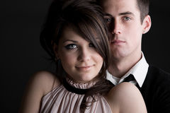 Young Couple against Dark Background Royalty Free Stock Photos