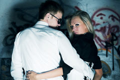 Young couple against a graffiti. Stock Photos