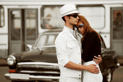 Young fashion couple in love at the retro car. Young fashion man and woman in love at the retro car Stock Photos