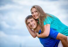 Young couple against the sky Stock Photography