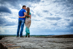 Young couple against the sky Royalty Free Stock Photography