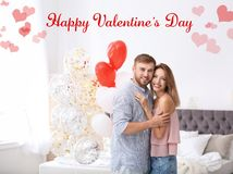 Young couple with air balloons in bedroom royalty free stock photos