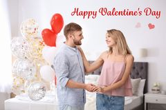 Young couple with air balloons. Celebration of Saint Valentine`s Day stock photography