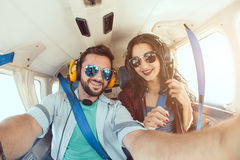 Young couple in airplane Stock Photography