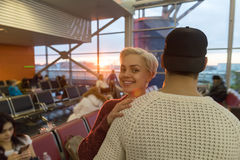 Young Couple In Airport Lounge Waiting Departure Happy Smile Man And Woman. Flight Royalty Free Stock Photography