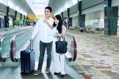 Young couple at airport Stock Image