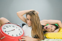 Young couple with alarm clock Stock Photography