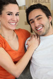 Young couple all smiles moving flats Royalty Free Stock Photos