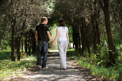 Young couple in the alley. Young men and women walking in the middle of an alley Royalty Free Stock Photo
