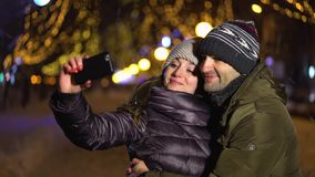 Happy couple taking a picture of themselves stock footage