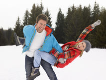 Young Couple In Alpine Snow Scene Stock Photo