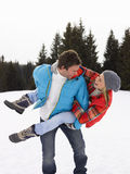 Young Couple In Alpine Snow Scene Royalty Free Stock Image