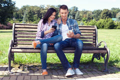 Young couple amazed watching smart phone outdoor Royalty Free Stock Photo