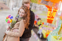 Young couple in the amusement park Royalty Free Stock Photography