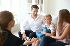 Free Young Couple And Their Son Meeting With Headmistress At School Stock Photography - 151243552