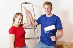 A young couple in the apartment Royalty Free Stock Photos