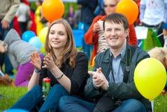 Young couple applauding Stock Photos