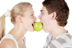 Young couple with apple Royalty Free Stock Photos