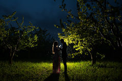 Young couple in the Apple orchard Royalty Free Stock Image