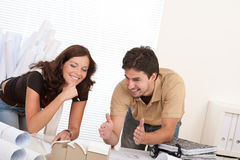 Young couple at architect office working Stock Photo