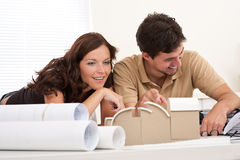 Young couple with architectural model Stock Photos