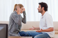 Young couple arguing. In their living room Royalty Free Stock Photos