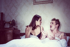 Young couple arguing in bed Stock Image