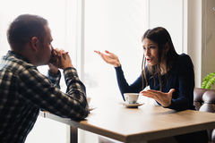 Young couple arguing in a cafe. Relationship problems. Royalty Free Stock Images