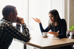 Young couple arguing in a cafe. Relationship problems. Stock Photo