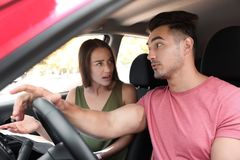 Young couple arguing in car. Front seats royalty free stock photos