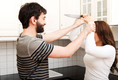 Young couple arguing in the kitchen. Royalty Free Stock Photo