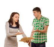 Young couple arguing over paperwork Royalty Free Stock Image