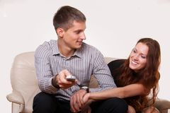 Young couple arguing over the TV remote Stock Images
