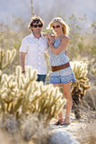 Young couple arm in arm in sunglasses in desert Royalty Free Stock Image