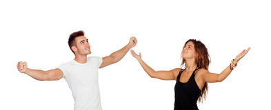 Young couple with arms raised celebrating something. Isolated on a white background stock image