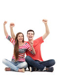Young couple with arms raised Royalty Free Stock Photography