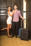 A young couple arriving to their Hotel room Stock Photos