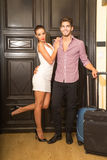 A young couple arriving to their Hotel room Stock Images