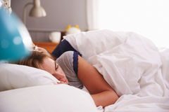 Young Couple Asleep in Bed Together Royalty Free Stock Photos