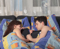 Young couple asleep with a tablet laptop Stock Photo
