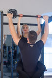 Young Couple Athlete Doing Pull Ups Training Back Together Royalty Free Stock Images